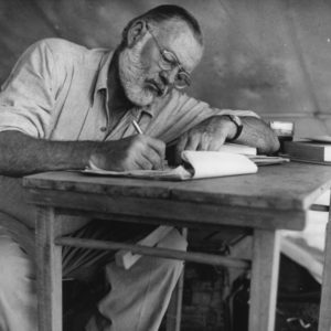 More Packing tips for men: Ernest Hemingway on a campsite in Kenya, 1926 (c) wikimedia commons
