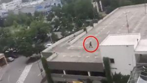 Shooter Ali David Sonboly on the rooftop of a nearby car park. Photo: YouTube