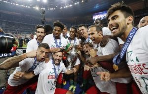 No more hissy fits: after swapping jerseys with the defeated French, Portugal poses for a victory shot. Photo: REUTERS