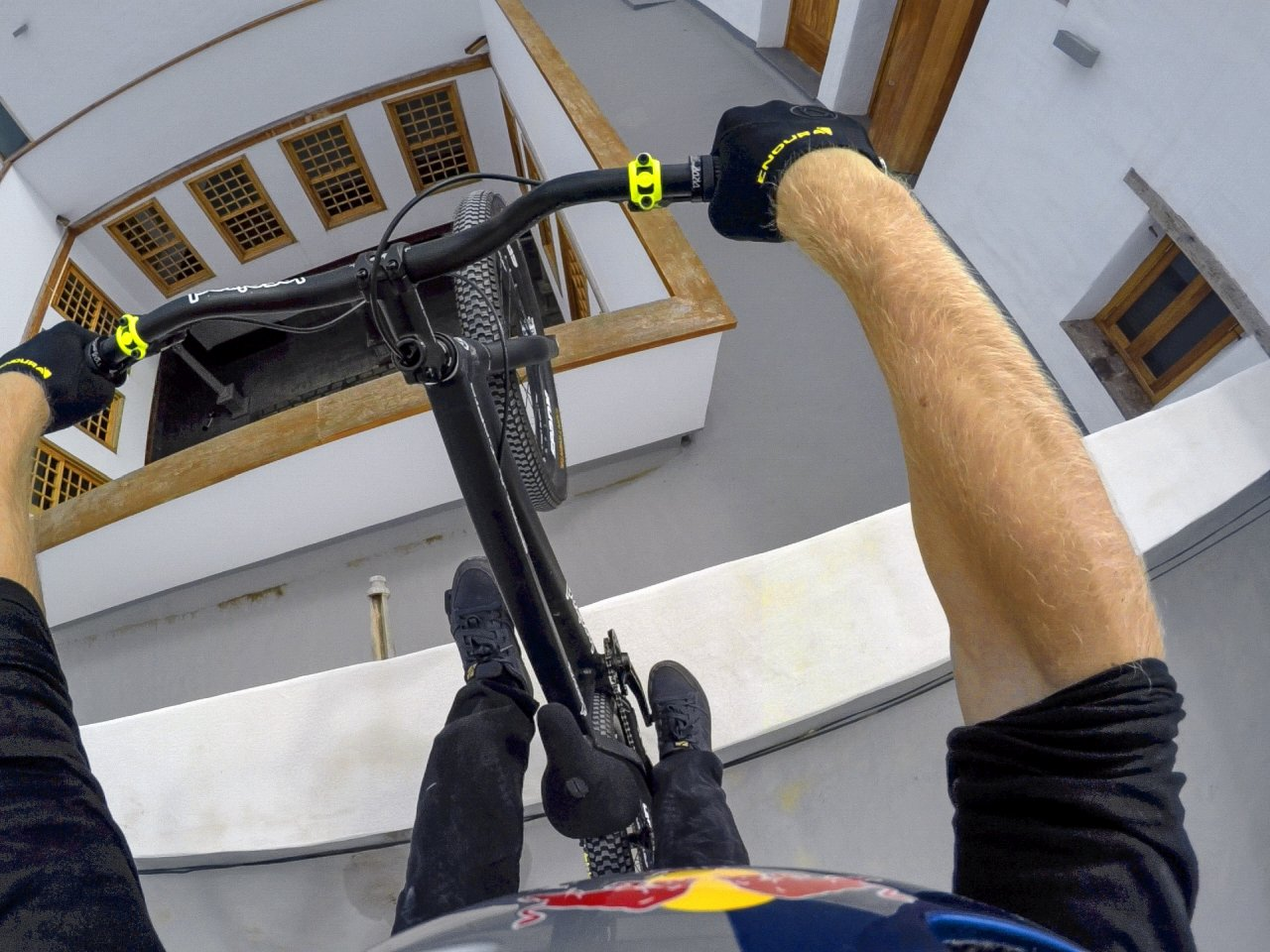 """Street trials rider Danny MacAskill riding his bike across the rooftops of picturesque Gran Canaria, Spain for his """"Cascadia"""" video. Photo: RedBull Content Pool"""